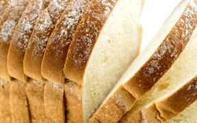 Closeup macro of loaf of bread with slices.