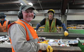 A photo of Alistair Hatton and Paul Burtenshaw on the recycling sortline