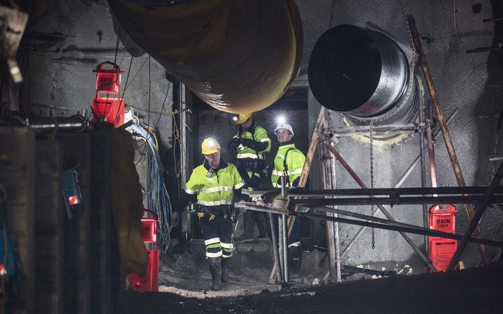 Geotechnical engineer Chris Lee, Mine Deputy Kirk Neilson and Chief Operating Officer Dinghy Pattinson opening the doors to the mine.