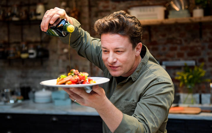 Jamie Oliver cooking at the One Kitchen Culinary School in Hamburg, Germany, in 2017.