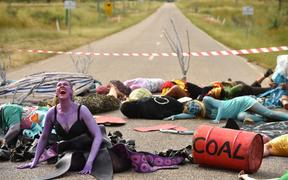 Environmental campaigners holding a protest against the development of the India-backed Adani coal mine.