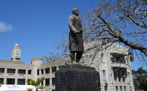 A statue of the Fiji statesman Ratu Sir Lala Sukuna stands guard outside Fiji's government buildings, Suva