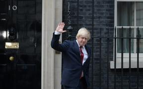 Boris Johnson waves as he leaves 10 Downing Street.