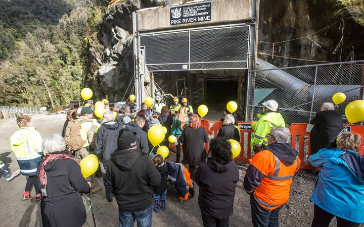 Families gather at the entrance to the mine for the re-entry yesterday.