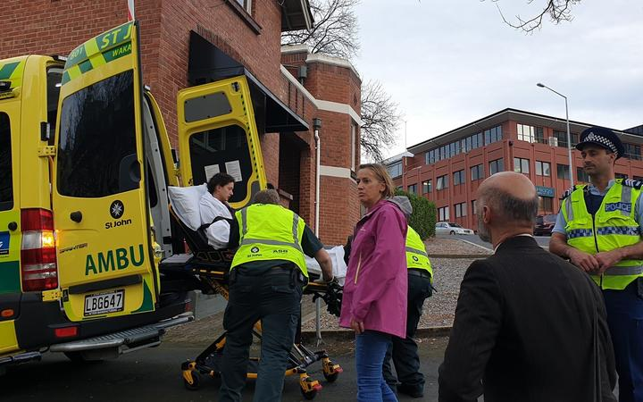 A protestor was treated by ambulance staff.