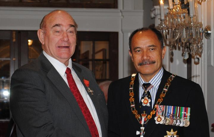 Dr Guy Jansen (left) receiving his MNZM in 2012 for services to music