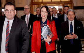 Finance Mrnister Grant Robertson and Prime Minister Jacinda Ardern arrive with Deputy Prime Minister Winston Peters in tow for the release of Budget 2019.