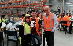 Martin Wylie with workers in the Altus Enterprises factory in Papatoetoe