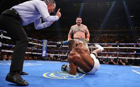Andy Ruiz Jr knocks down Anthony Joshua in the third round during their IBF/WBA/WBO heavyweight title fight at Madison Square Garden.