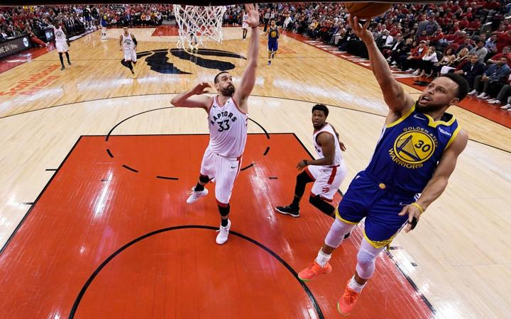 Stephen Curry #30 of the Golden State Warriors attempts a shot against Marc Gasol #33 of the Toronto Raptors during Game Two of the 2019 NBA Finals.