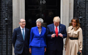 Britain's Prime Minister Theresa May and her husband Philip May greet US President Donald Trump and US First Lady Melania Trump.