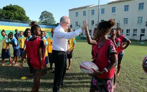 Australia's Prime Minister Scott Morrison plays rugby with school children in Honiara.