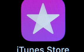09 April 2019, Hessen, Rüsselsheim: ILLUSTRATION - The iTunes Store icon (Application software) is visible on the screen of an iPhone. Photo: Silas Stein/dpa