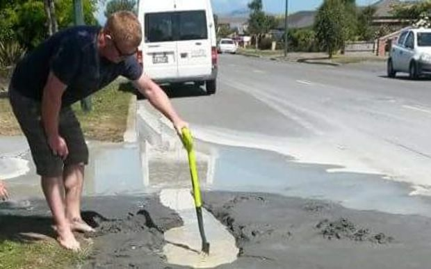 A man checks out the liquefaction following Christchurch's 5.7 magnitude quake.