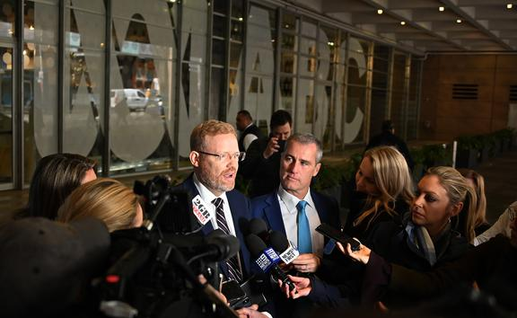 ABC editorial director Craig McMurtrie speaks to the media as police raid the headquarters of public broadcaster in Sydney on 5 June.