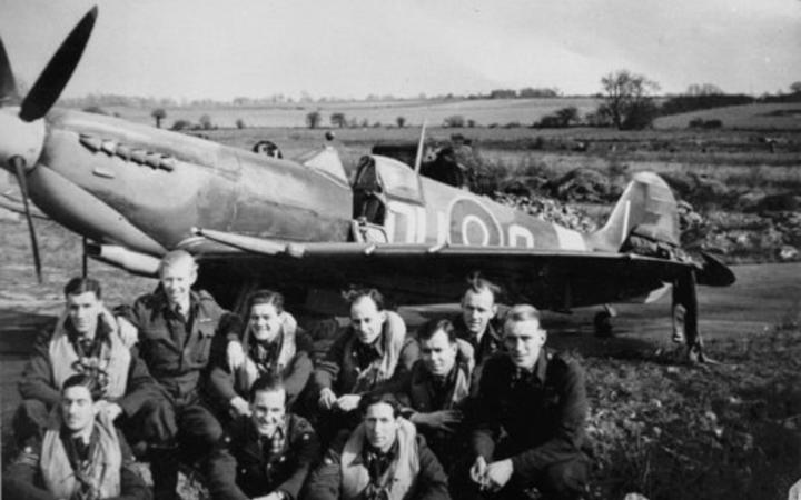 A group of No 485 Squadron pilots in front of one of their aircraft at RAF Station Selsey, at the dawn of D Day.