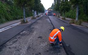 Plastic asphalt Plas Mix road resurfacing.