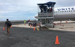 People boarding a flight in Majuro bound for Guam