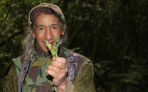 Charles with a pikopiko (fern) in Hinehopu forest, Rotoiti.