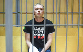 Russian investigative journalist for Meduza website Ivan Golunov waits in a court room, in Moscow's Nikulinsky Court, Russia.