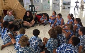 Otago Museum staff share their climate change message with children in the Cook Islands.
