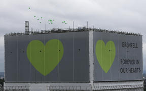 Balloons are released from the top of Grenfell Tower on the anniversary of the Grenfell fire in west London on June 14.