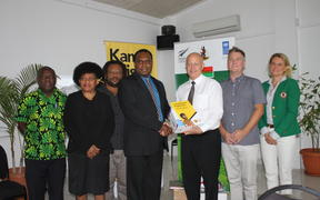 New Zealand High Commissioner to Vanuatu Jonathan Schwass handing over equipment to Cabinet Minister Andrew Napuat