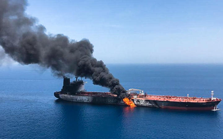 Smoke billows from Norwegian-owned Front Altair tanker in the Gulf of Oman.(Picture obtained by AFP from Iranian News Agency ISNA on 13 June, 2019).