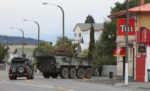 A Defence Force LAV (light armoured vehicle) heads up Chaucer Road during the Napier Siege.