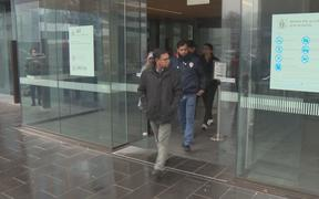 People leave the High Court in Christchurch after Brenton Tarrant pleads not guilty