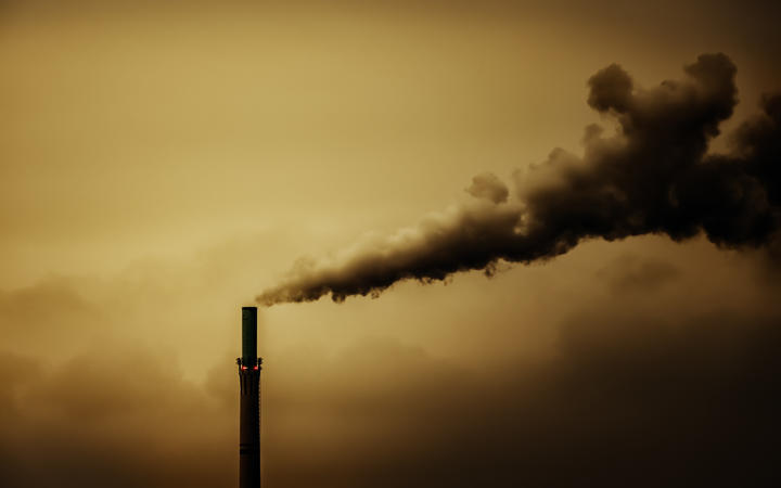 Industrial air pollution smoke chimney.