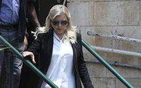 Sara Netanyahu, wife of Israeli Prime Minister Benjamin Netanyahu, leaves the Magistrate's Court in Jerusalem on June 16, 2019, following her conviction of fraudulently using state funds for catering.
