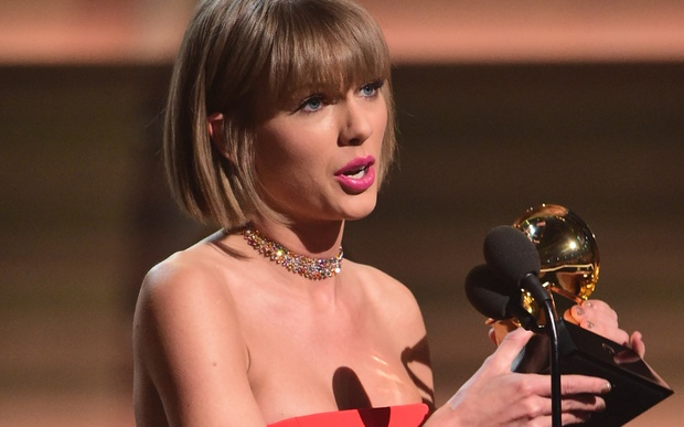 Singer Taylor Swift accepts the award for the Album of the Year onstage during the 58th Annual Grammy music Awards in Los Angeles February 15, 2016.