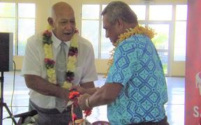The Reverend Apineru Lafai (left) hands keys over to the Minister of Sports Loau Keneti Sio