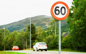 60km/h speed limit road sign.