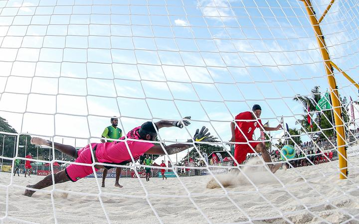 Tahiti's Heirauarii Salem scores the opening goal of their match against Vanuatu at the OFC Beach Soccer Nations Cup 2019.