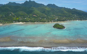 Aerial landscape view of the beautiful Muri Lagoon and a Motu (Islet) in Rarotonga Island in the Cook Islands.