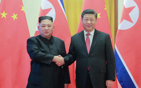 North Korea's leader Kim Jong Un (left) shaking hands with China's President Xi Jinping during a welcome ceremony at the Great Hall of the People in Beijing in January, 2019.
