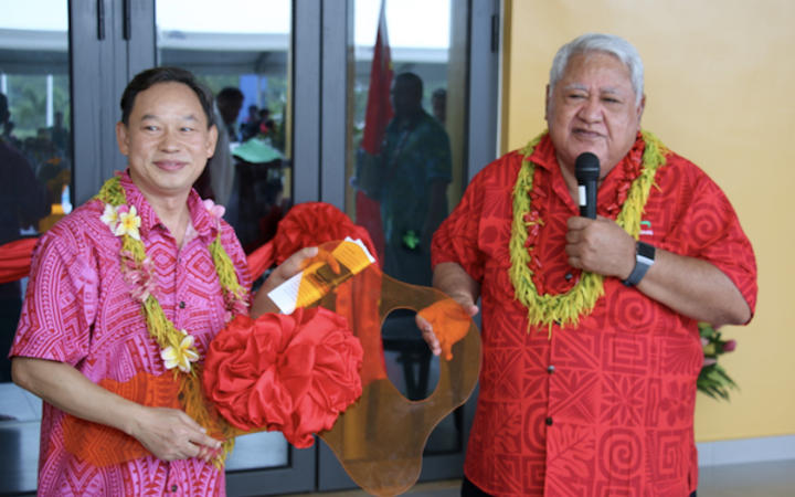 The ambassador of the People's Republic of China, Chao Xiaoliang hands over the key for the Multi-Sport Centre to Samoa Prime Minister Tuilaepa at the handover ceremony on 20 June 2019.
