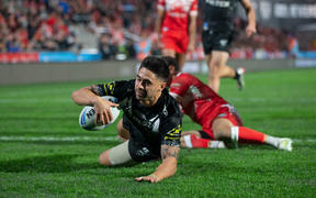 Kiwis player Shaun Johnson scores against Tonga, during rugby league Test match between Kiwis and Tonga, held at Mt Smart Stadium.
