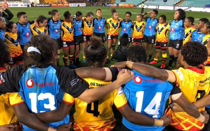 The Fiji Bulikula and the PNG Orchids huddle after their first ever meeting which Fiji won 28-0