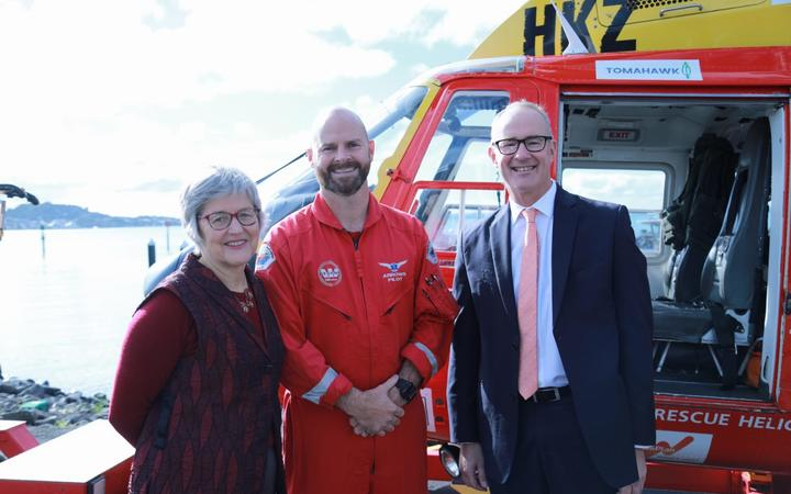 Land Information Minister Eugenie Sage and Transport Minister Phil Twyford with rescue helicopter pilot, Rob Arrowsmith.