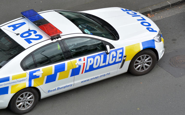 AUCKLAND - MAR 30 2017:New Zealand Police car and officer during a crime respond in Auckland, New Zealand.
