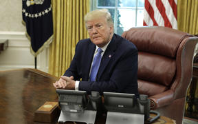 US President Donald Trump listens during a meeting on the the opioid epidemic in the Oval Office at the White House in Washington, D.C., on June 25, 2019. | usage worldwide