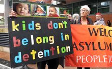 Protestors in Sydney ask the government not to send asylum-seekers back to Nauru