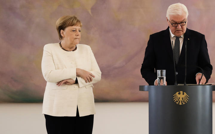 Germany`s Merkel seen shaking again, but heads to...