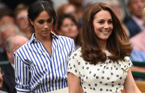 Catherine, Duchess of Cambridge, and Meghan, Duchess of Sussex take their seats at the 2018 Wimbledon Championships