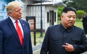 North Korea's leader Kim Jong Un speaks as he stands with US President Donald Trump south of the Military Demarcation Line that divides North and South Korea, in the Joint Security Area (JSA) of Panmunjom in the Demilitarized zone (DMZ)