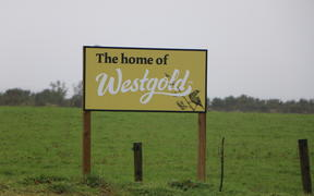 A sign promoting Westgold Butter made by Westland Milk Products.