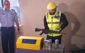 Police demonstrate how guns will be destroyed under the buy-back scheme.